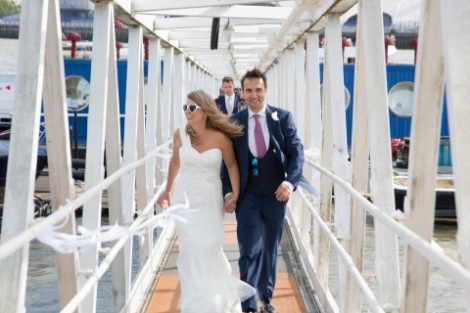 THE HAPPY COUPLE ARRIVE BY BOAT