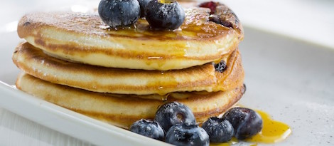 American Buttermilk pancakes with blueberries and maple syrup